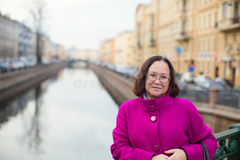 Middle aged woman on a street of St. Petersburg. Russia stock photography