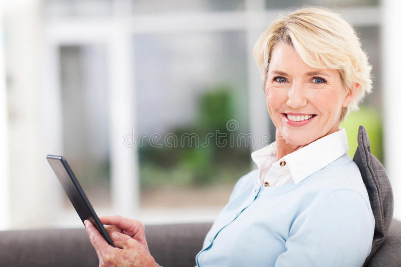 Middle aged woman tablet stock photos