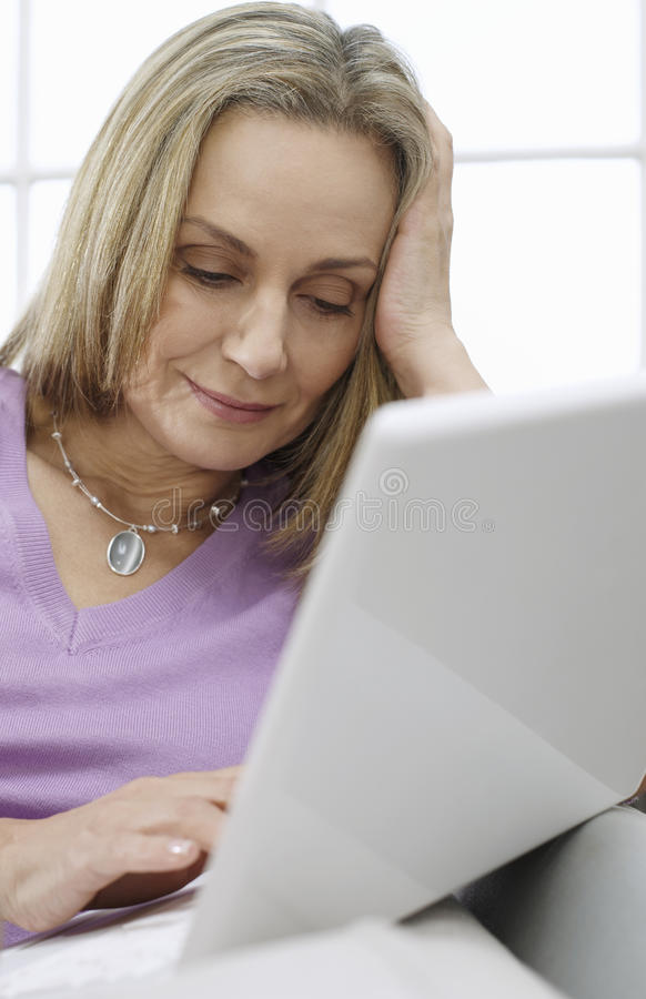 Middle Aged Woman Using Laptop royalty free stock photo
