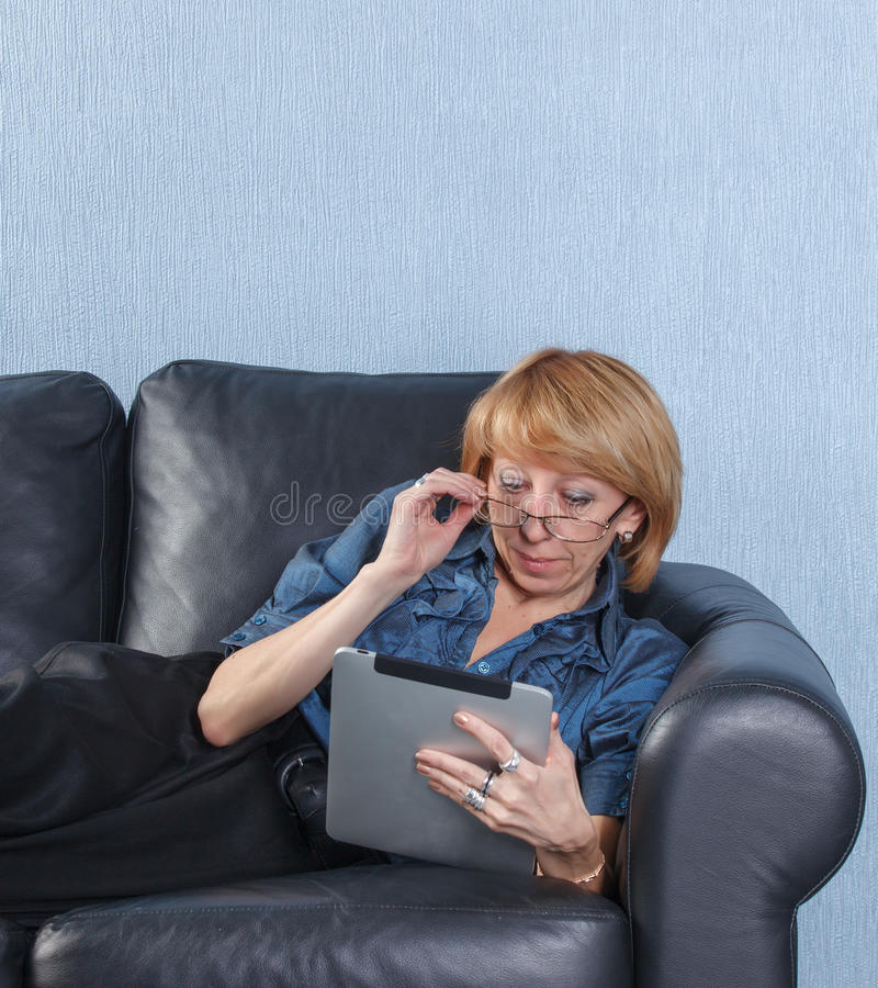 Download Middle Aged Woman Using Tablet PC On Couch Stock Image - Image: 23860767