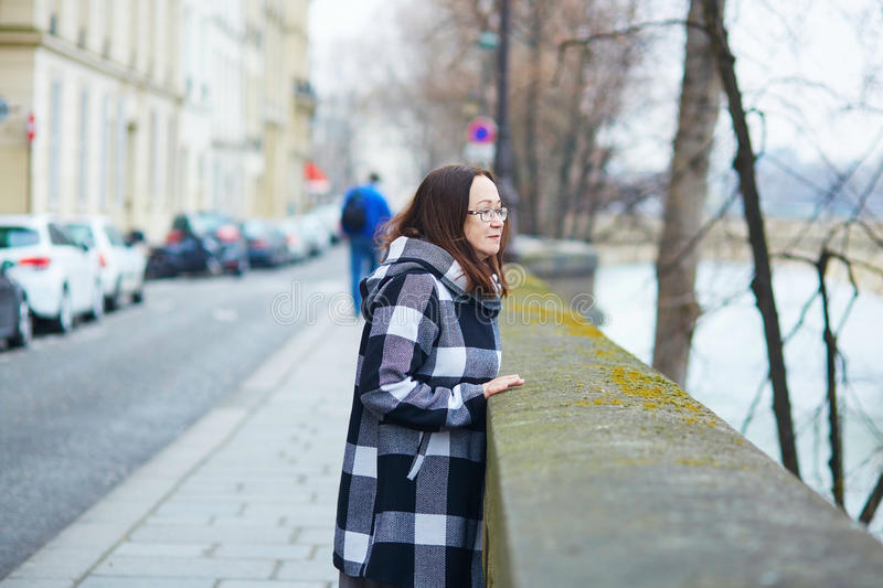 Middle aged woman walking in Paris. France royalty free stock photography