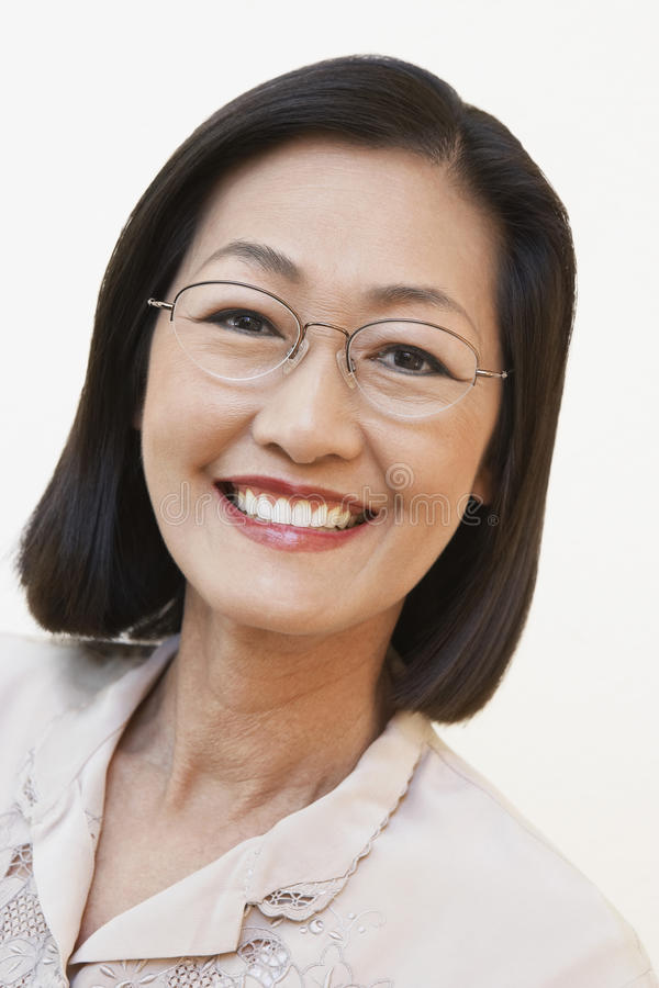 Middle Aged Woman Wearing Glasses. Closeup portrait of a middle aged woman wearing glasses royalty free stock images