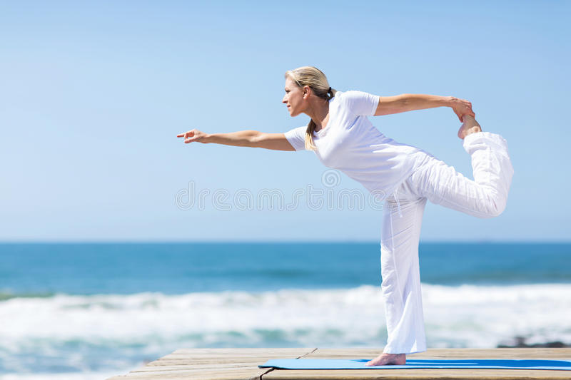 Middle aged woman yoga stock image