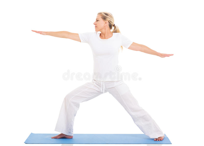 Middle aged woman yoga. Healthy middle aged woman practicing yoga exercise on white background royalty free stock images