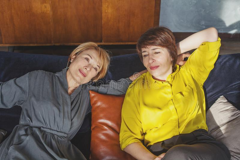 Middle aged women resting, smiling and chatting royalty free stock photo