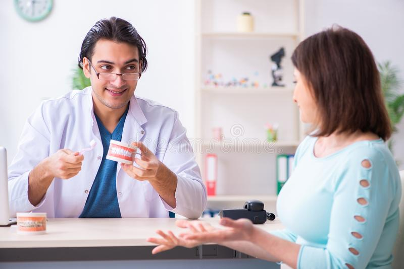 Middle-aged woman visiting male doctor stomatologist. The middle-aged women visiting male doctor stomatologist royalty free stock photo