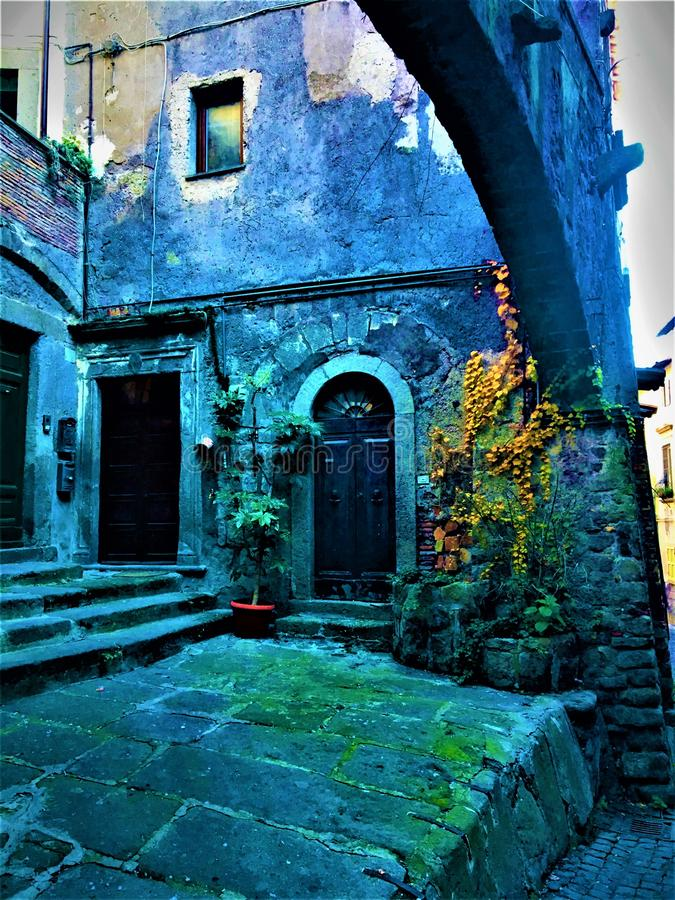 Middle Ages, arch, plants, doors and stones. Enchanting corner and history. Middle Ages, arch, plants, doors, ancient buildings, stones, enchanting corner royalty free stock photos