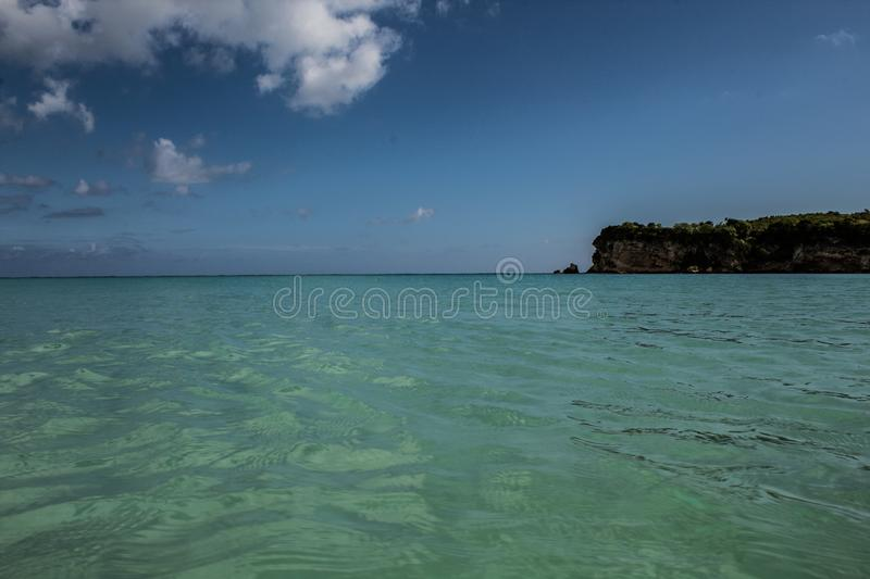 In the middle of an amazing, green and turquoise caribbean sea; transparent water, tropical paradise. Playa Macaro, Punta Cana, stock photography