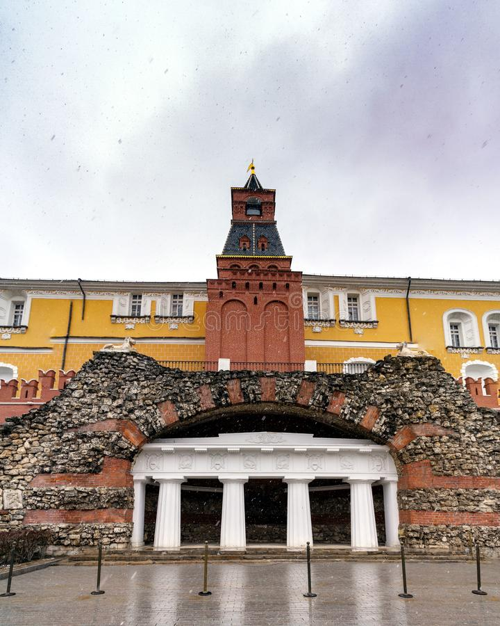 The middle Arsenal Tower of the Kremlin and the grotto of the ruins stock photos