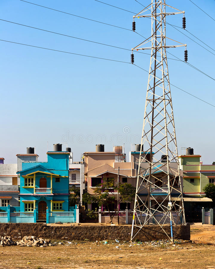 Middle class housing in India. Housing for the growing middle class and part of the electricity infrastructure needed in the rapidly developing city of Bhuj royalty free stock image