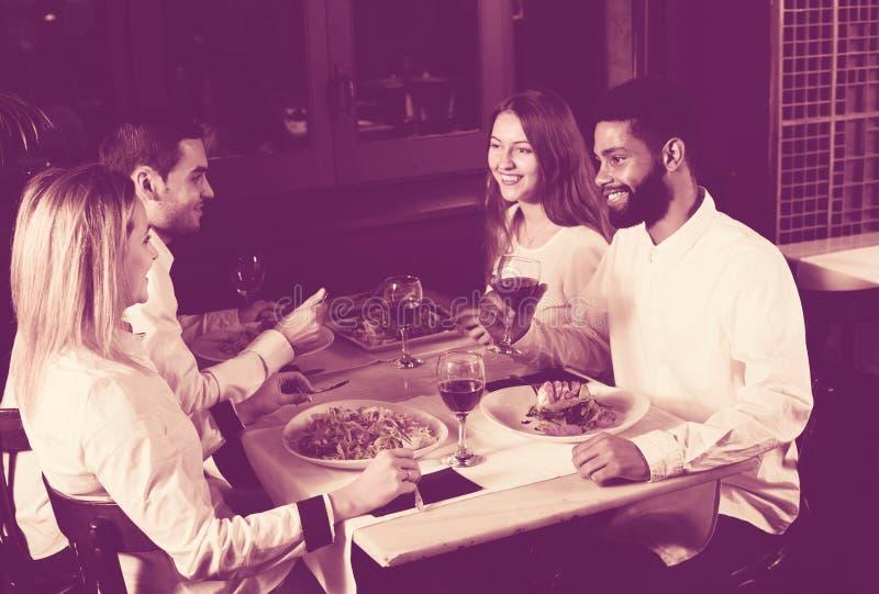 Middle class people enjoying food stock image