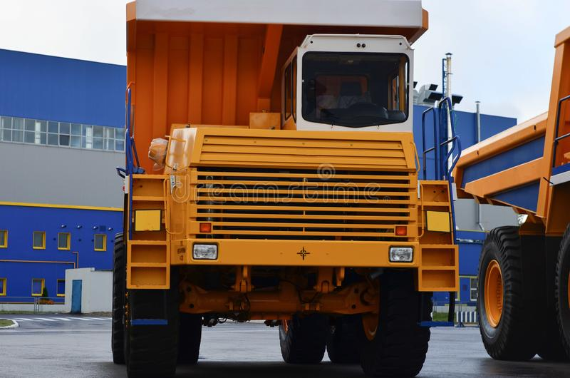 The middle class yellow mining dump truck for work on transportation of sand and minerals in mines. Close-up stock photo