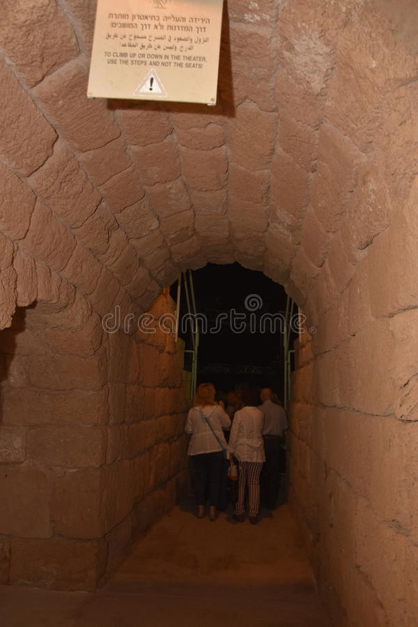 Middle East ,Caesarea Amphitheater, Israel, May 19 -Spectators go through the ancient arch to the concert in Caesarea amphitheater royalty free stock images