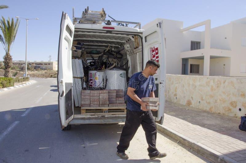 Middle East- Mitzpe Ramon, Israel,The car company Hom-Hanegev installation of solar water heaters and working with bricks. Middle East- Mitzpe Ramon, Israel stock photo