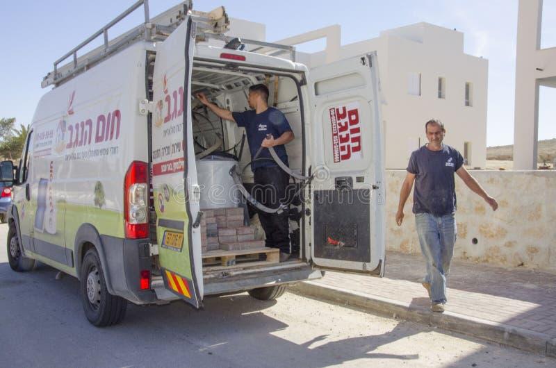 Middle East- Mitzpe Ramon, Israel. February 29,The car company Hom-Hanegev installation of solar water heaters and workings. Middle East- Mitzpe Ramon, Israel royalty free stock photo