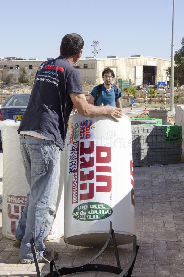 Middle East- Mitzpe Ramon, Israel. February 29,The installation of new solar water heaters companies `Hom-Hanegev`. On the roofs of the houses being built ` stock photo