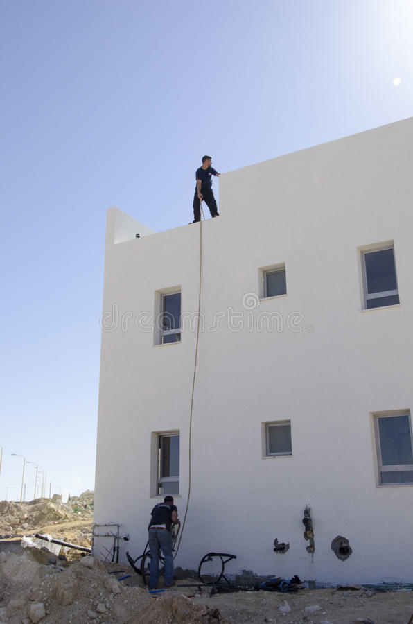 Middle East- Mitzpe Ramon, Israel. February 29,The installation of new solar water heaters companies `Hom-Hanegev`. On the roofs of the houses being built ` stock image