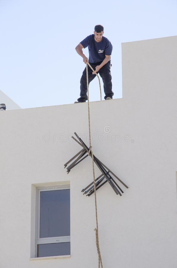 Middle East- Mitzpe Ramon, Israel. February 29,The installation of new solar water heaters. Companies `Hom-Hanegev` on the roofs of the houses being built ` royalty free stock photos