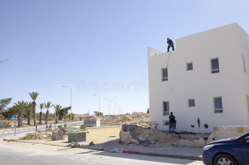 Middle East- Mitzpe Ramon, Israel. February 29,The installation of new solar water heaters. Companies `Hom-Hanegev` on the roofs of the houses being built ` stock photo