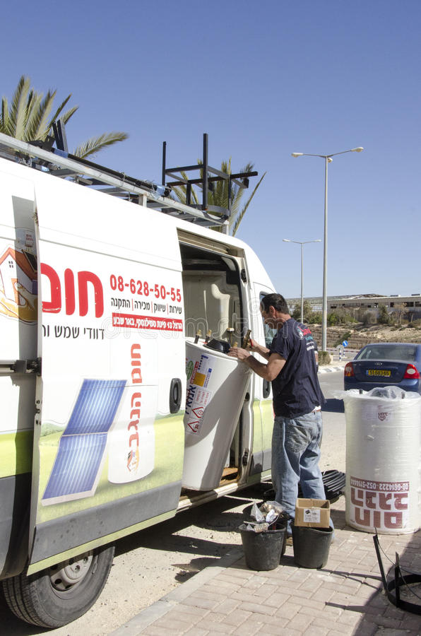 Middle East- Mitzpe Ramon, Israel. February 29, Work on Roni Sassi gets solar boiler of the machine. Middle East- Mitzpe Ramon, Israel. February 29,The stock image