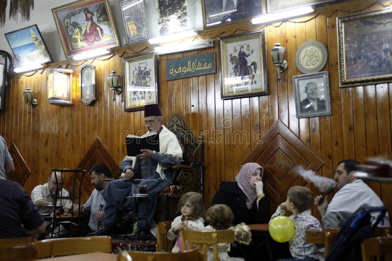 MIDDLE EAST SYRIA DAMASKUS STORYTELLER. The storyteller Abu Shady ii Cafe An Nafura in the market or souq in the old town in the city of Damaskus in Syria in the royalty free stock images