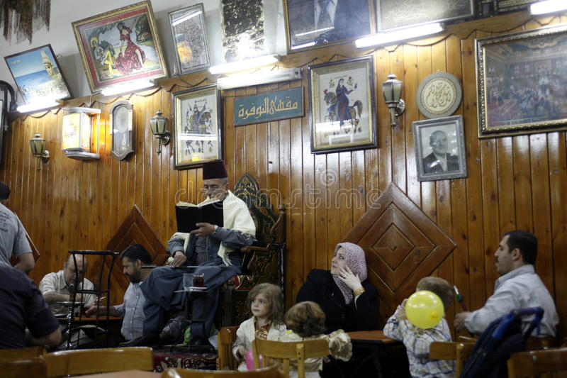 MIDDLE EAST SYRIA DAMASKUS STORYTELLER. The storyteller Abu Shady ii Cafe An Nafura in the market or souq in the old town in the city of Damaskus in Syria in the stock photos