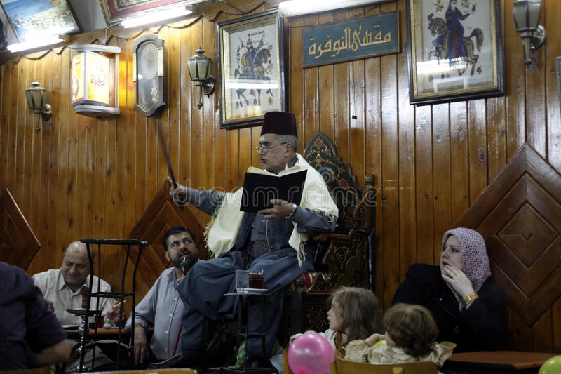 MIDDLE EAST SYRIA DAMASKUS STORYTELLER. The storyteller Abu Shady ii Cafe An Nafura in the market or souq in the old town in the city of Damaskus in Syria in the stock images