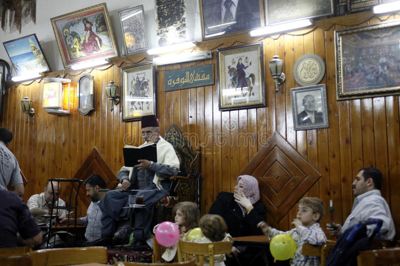 MIDDLE EAST SYRIA DAMASKUS STORYTELLER. The storyteller Abu Shady ii Cafe An Nafura in the market or souq in the old town in the city of Damaskus in Syria in the royalty free stock photos