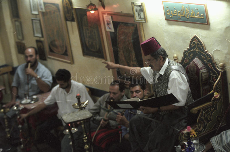MIDDLE EAST SYRIA DAMASKUS STORYTELLER. The storyteller Abu Shady ii Cafe An Nafura in the market or souq in the old town in the city of Damaskus in Syria in the stock image