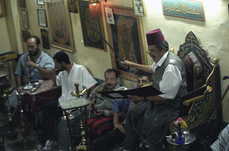 MIDDLE EAST SYRIA DAMASKUS STORYTELLER. The storyteller Abu Shady ii Cafe An Nafura in the market or souq in the old town in the city of Damaskus in Syria in the stock photography