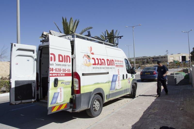 Middle Eastd- Mitzpe Ramon, Israel. February 29, -The car company Hom-Hanegev installation of solar water heaters stock photo