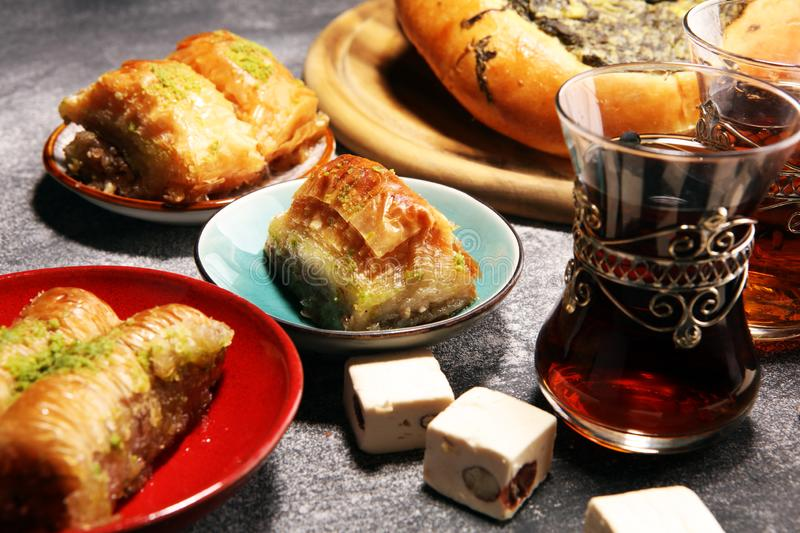 Middle eastern or arabic dishes and assorted meze, concrete rustic background. sambusak. Turkish Dessert Baklava with pistachio. Halal food.. Lebanese royalty free stock photo