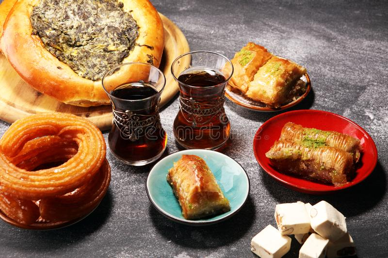 Middle eastern or arabic dishes and assorted meze, concrete rustic background. sambusak. Turkish Dessert Baklava with pistachio. Halal food.. Lebanese stock images