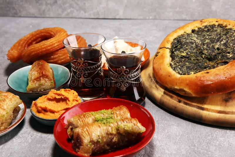 Middle eastern or arabic dishes and assorted meze, concrete rustic background. sambusak. Turkish Dessert Baklava with pistachio. Middle eastern or arabic dishes stock photos