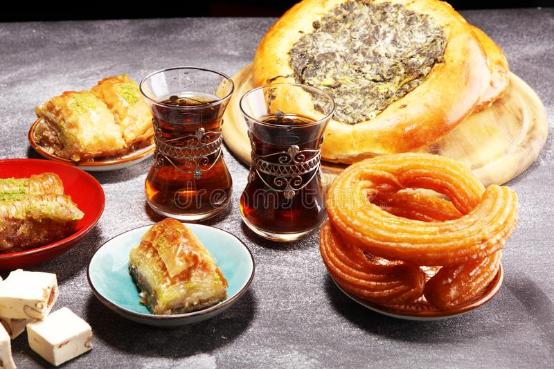 Middle eastern or arabic dishes and assorted meze, concrete rustic background. sambusak. Turkish Dessert Baklava with pistachio. Halal food.. Lebanese stock photo