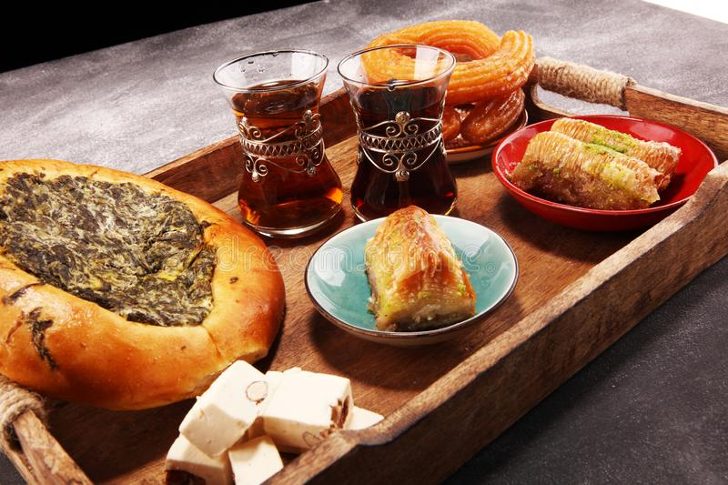 Middle eastern or arabic dishes and assorted meze, concrete rustic background. sambusak. Turkish Dessert Baklava with pistachio. Middle eastern or arabic dishes stock image