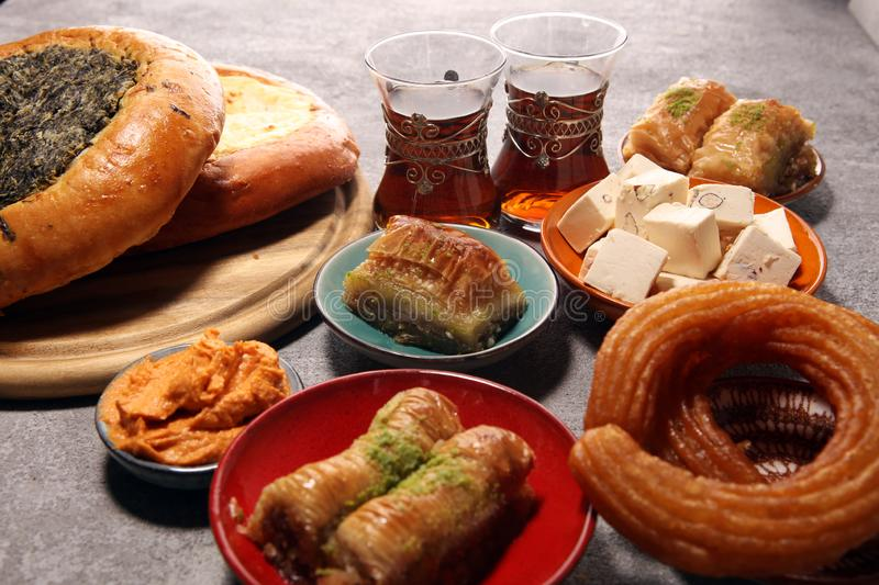 Middle eastern or arabic dishes and assorted meze, concrete rustic background. sambusak. Turkish Dessert Baklava with pistachio. Middle eastern or arabic dishes stock photo