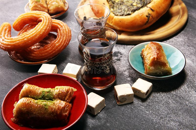 Middle eastern or arabic dishes and assorted meze, concrete rustic background. sambusak. Turkish Dessert Baklava with pistachio. Middle eastern or arabic dishes stock images