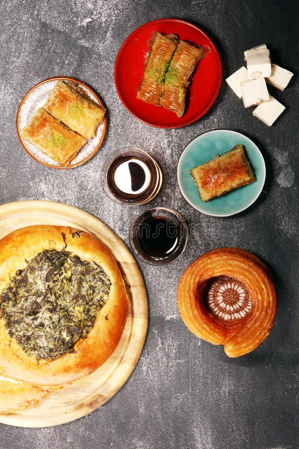 Middle eastern or arabic dishes and assorted meze, concrete rustic background. sambusak. Turkish Dessert Baklava with pistachio. Middle eastern or arabic dishes royalty free stock photography