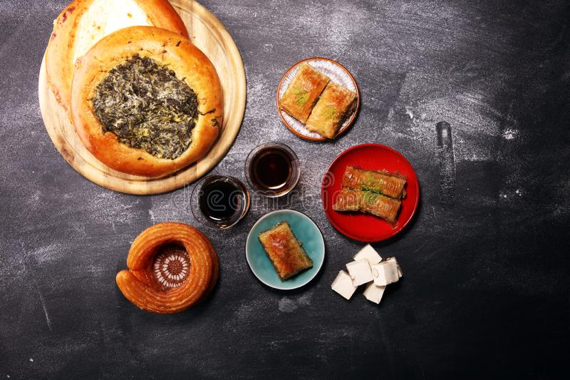 Middle eastern or arabic dishes and assorted meze, concrete rustic background. sambusak. Turkish Dessert Baklava with pistachio. Middle eastern or arabic dishes royalty free stock images