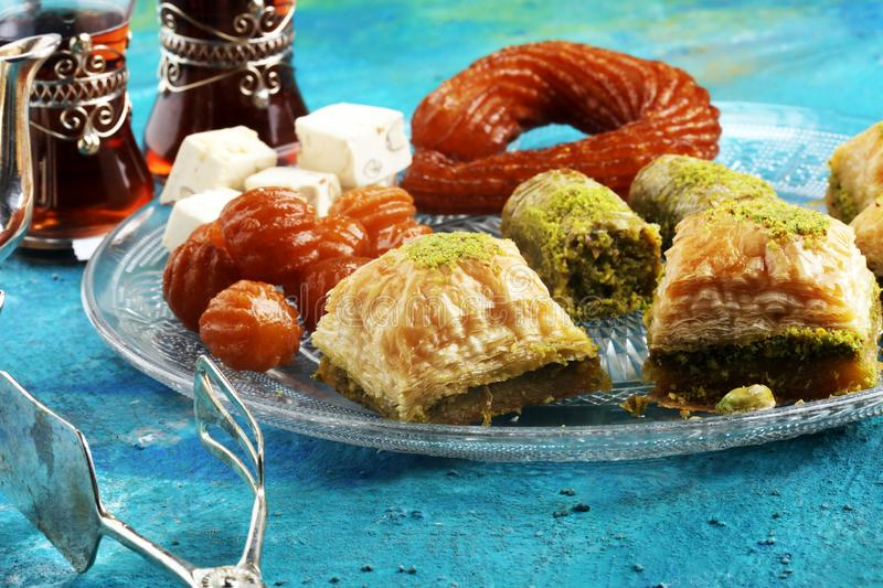 Middle eastern or arabic dishes. Turkish Dessert Baklava with pistachio on dishes. Middle eastern or arabic dishes. Turkish Dessert Baklava with pistachio stock images