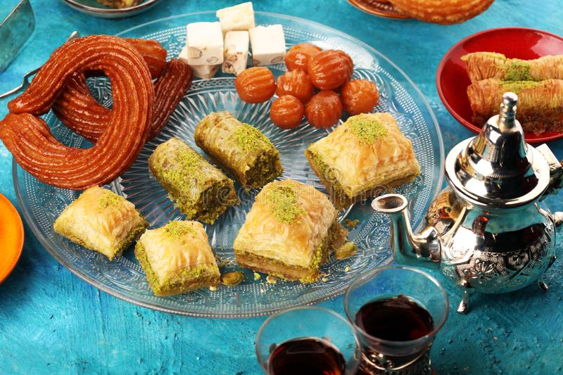 Middle eastern or arabic dishes. Turkish Dessert Baklava with pistachio on dishes. Middle eastern or arabic dishes. Turkish Dessert Baklava with pistachio royalty free stock photography