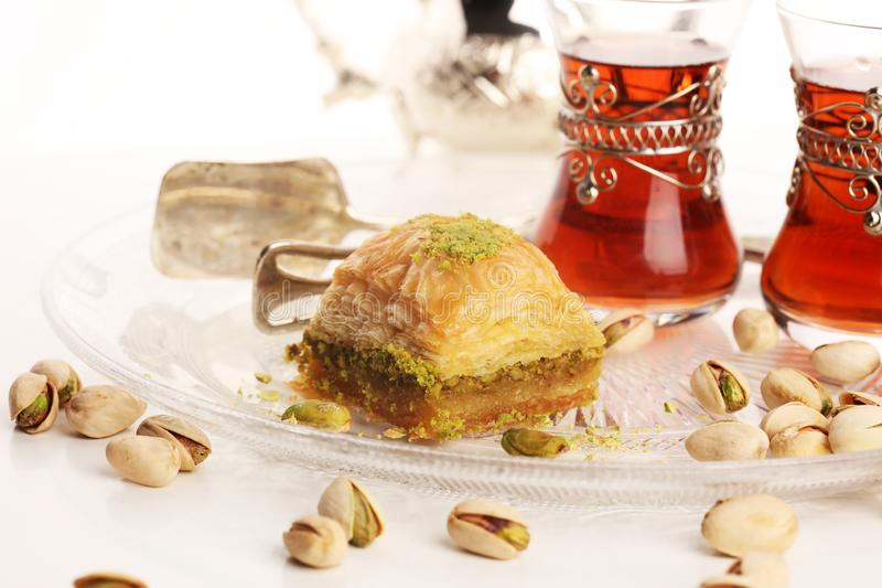 Middle eastern or arabic dishes. Turkish Dessert Baklava with pistachio on dishes. Middle eastern or arabic dishes. Turkish Dessert Baklava with pistachio royalty free stock photos