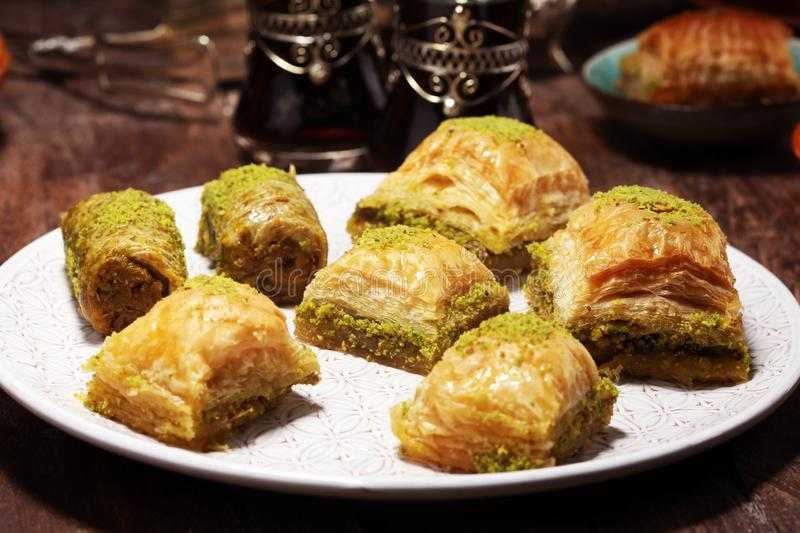 Middle eastern or arabic dishes. Turkish Dessert Baklava with pistachio on dishes. Middle eastern or arabic dishes. Turkish Dessert Baklava with pistachio stock photo