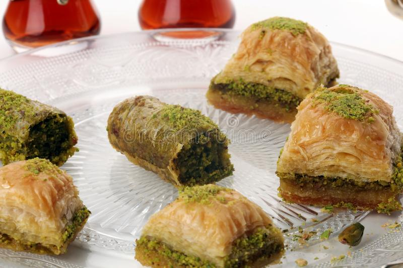 Middle eastern or arabic dishes. Turkish Dessert Baklava with pistachio on dishes. Middle eastern or arabic dishes. Turkish Dessert Baklava with pistachio stock photos
