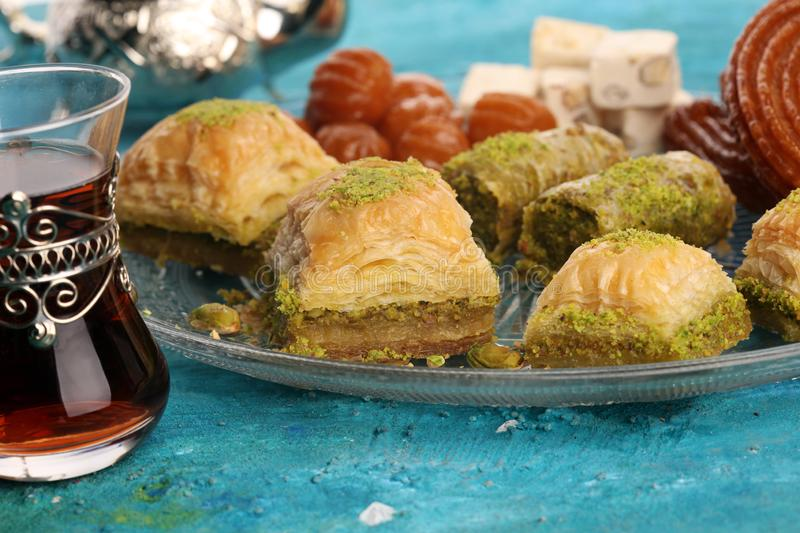 Middle eastern or arabic dishes. Turkish Dessert Baklava with pistachio on dishes. Middle eastern or arabic dishes. Turkish Dessert Baklava with pistachio royalty free stock image