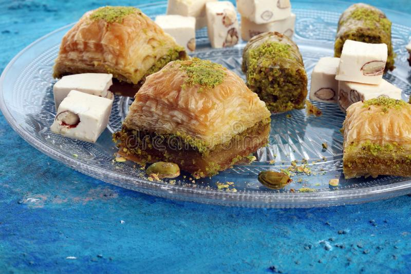 Middle eastern or arabic dishes. Turkish Dessert Baklava with pistachio on dishes. Middle eastern or arabic dishes. Turkish Dessert Baklava with pistachio stock photography