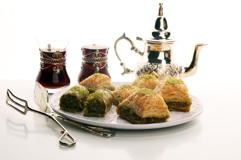 Middle eastern or arabic dishes. Turkish Dessert Baklava with pistachio on dishes. Middle eastern or arabic dishes. Turkish Dessert Baklava with pistachio stock image