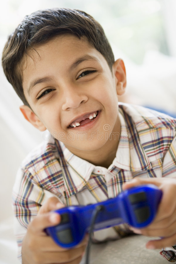 Download Middle Eastern Boy Playing A Video Game Stock Image - Image of arabic, colour: 6079609
