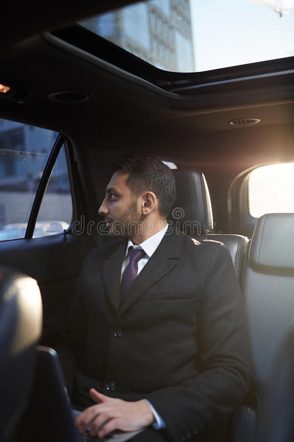 Middle-Eastern Businessman in Expensive Car stock photo